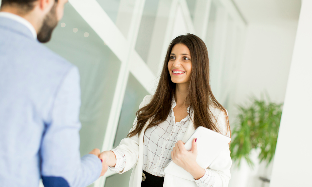 woman shaking hand with project manager
