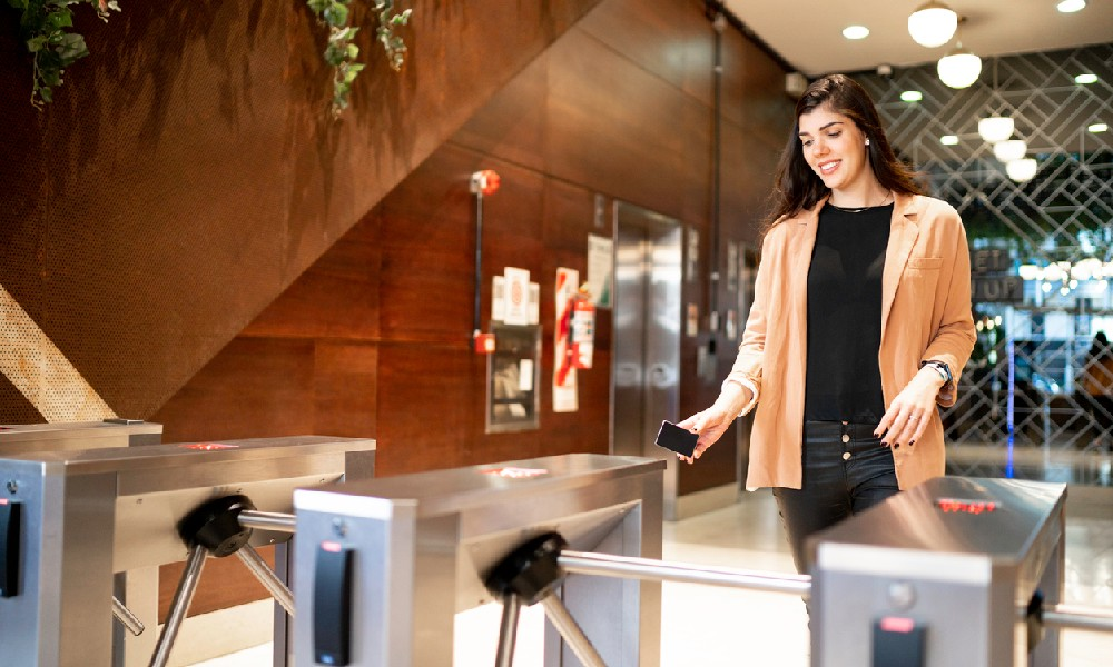 A businesswoman leaves an office lobby, which is a space usually subject to common-area maintenance charges
