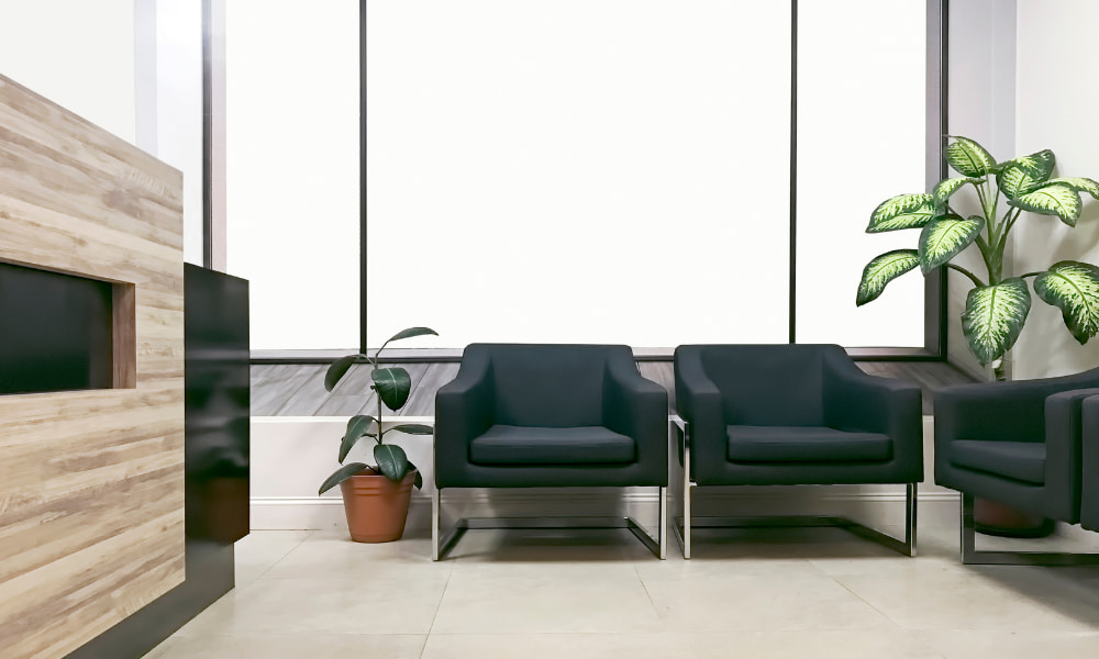 A digital render of an empty waiting room of a medical office floor plan