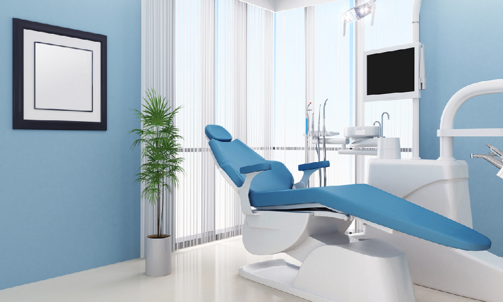 Calming blue paint with plants, artwork, and furniture highlight some good ideas for a dental office decorating approach.