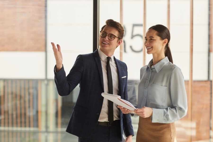 Business owner and their real estate advisor looking into buying commercial property